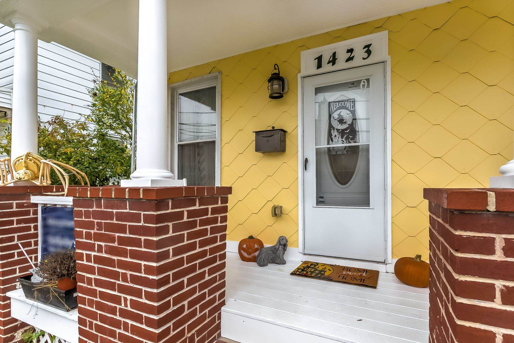 Single Family Homes for Sale at Rarely Available 1800s Hampden Duplex with Historic Shingle Siding on The Avenue Baltimore, Maryland 21211 United States