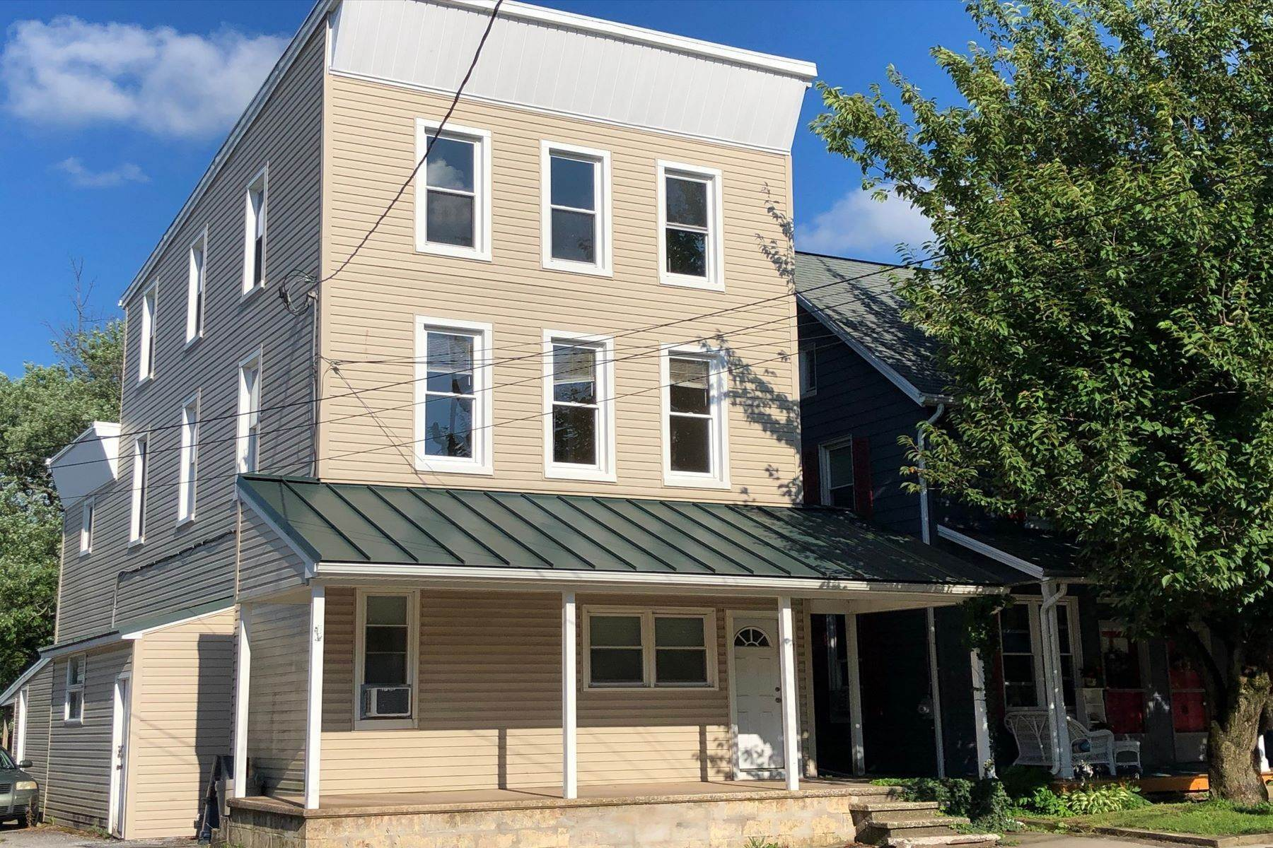 Multi-Family Homes for Sale at Stewartstown Three Unit Investment Opportunity 7 Main Street Stewartstown, Pennsylvania 17363 United States